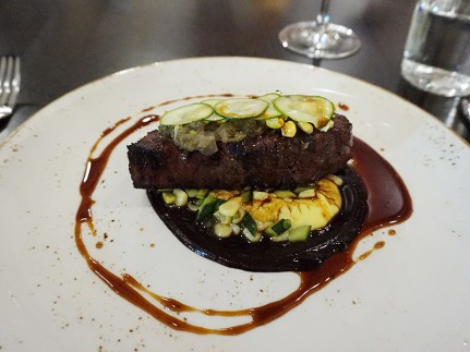Bison Striploin: bone marrow, king oyster mushrooms, corn, garlic scapes, natural jus