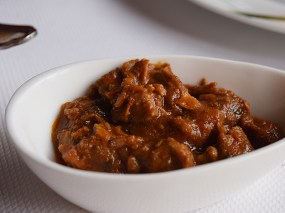 The somewhat ordinary meat curry that emerges from it.