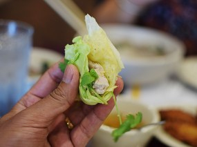 You wrap the pancake stuffing in a bit of pancake and then roll it up with mint in cabbage leaves, dip it in the sweet/spicy sauce and eat it.