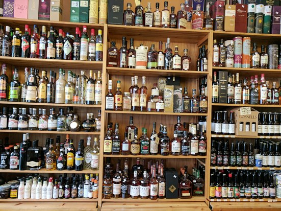 The American whiskey and other spirits are closer to the door.