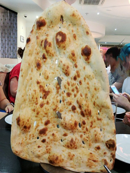 It rubs the ghee on its skin. Kidding aside, this was a pretty good naan.