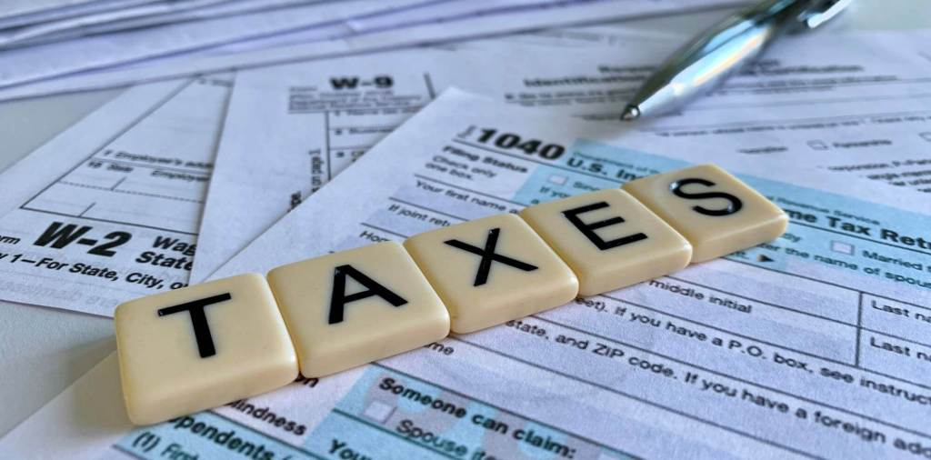 Are annuities taxable guide picture of scrabble tiles spelling taxes on top of tax return form