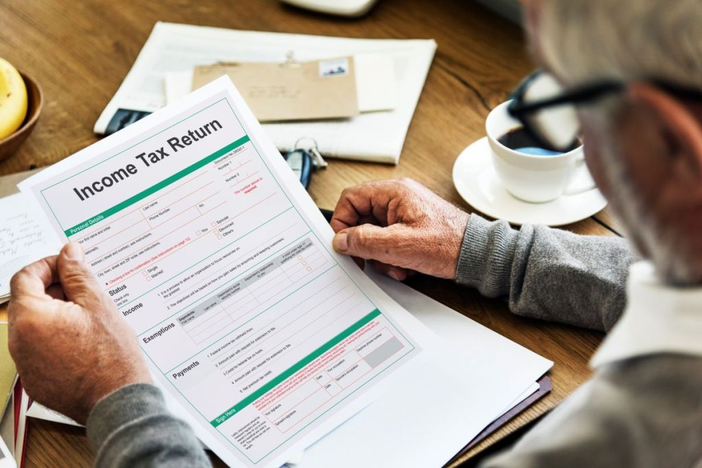 Are annuities taxable page picture of older gentleman look at income tax forms