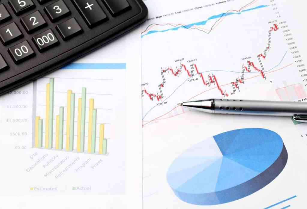 Allianz benefit control annuity review with calculator sitting on annuity charts