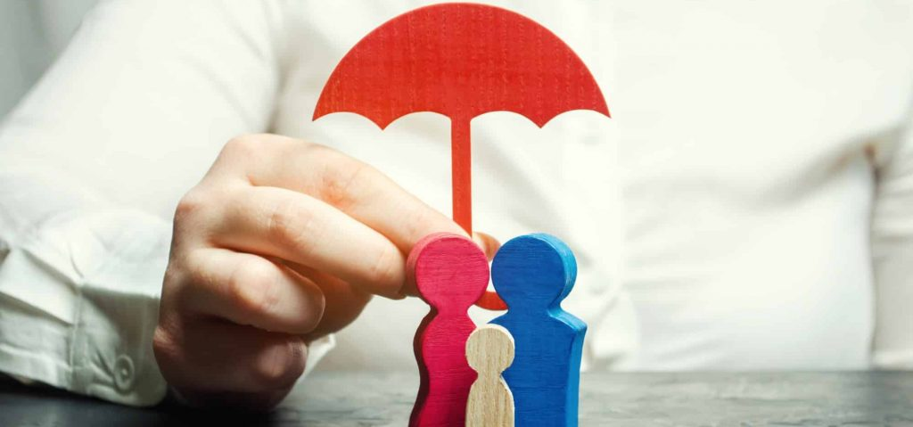 Top rated life insurance companies picture of insurance agent holding umbrella over a family