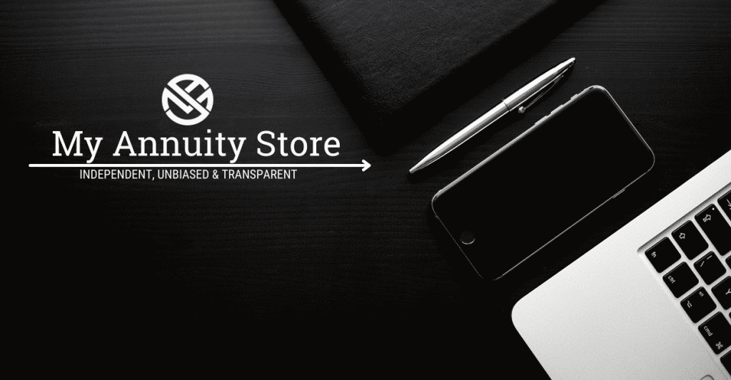 White modern laptop sitting on black matte desk - best free annuity calculators curated list by my annuity store, inc.
