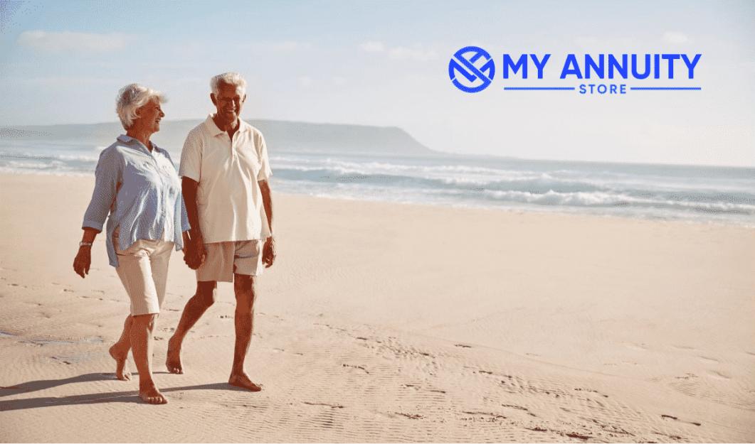 Retired Couple Walking on Beach