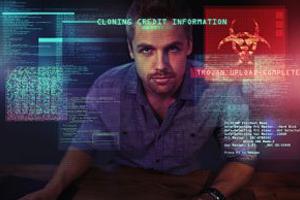 Computer hacker staring through computer screen