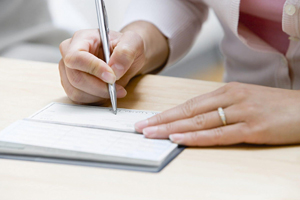 Married woman writing check out at home