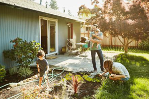 Family planting a garden in their backyard