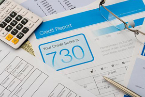 Calculator and papers with credit rating on desk