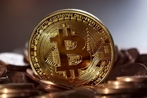 """a gold coin etched with the Bitcoin """"Capital B with vertical strokes"""" and circuit traces in the background"""
