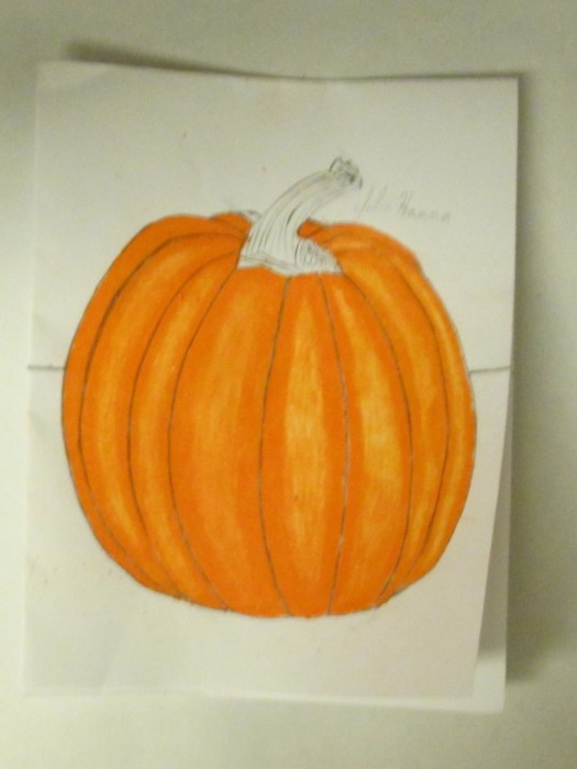 In this photograph I finally finished coloring in the orange portion of the pumpkin.