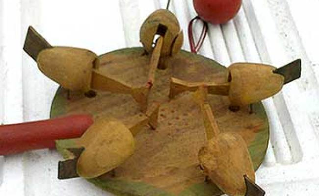 A Pecking Chicken Paddle Toy Auction Finds