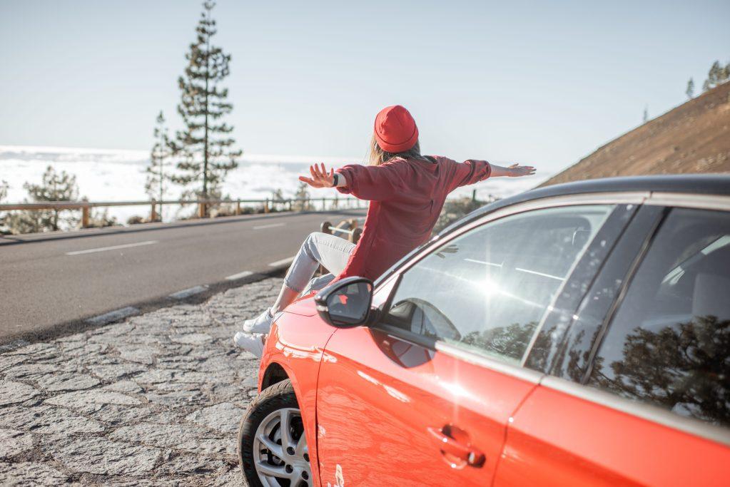 Woman on top of car hood