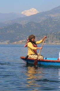 Rowing over Lake Phewa by the Annapurna Mountains