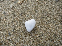 Heart shaped stone in the sand