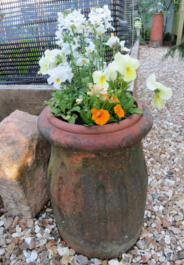 Chimney by a raised bed