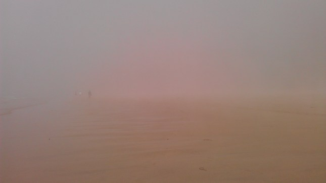 Pink mist across the beach