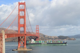 The Golden Gate bridge and a container vessel