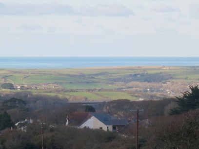 Overlooking our house (the yellow half) and on to the sea