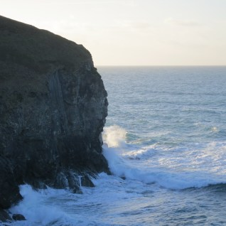 The waves crashing against the cliffs at Chapelporth on Cornwall's North coast
