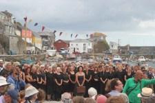 Choir 100 waiting to sing. Director Bill Mitchell in the green shirt.JPG