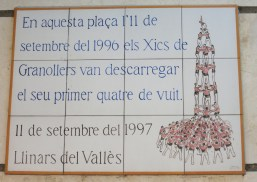 The plaque on the wall in the village square