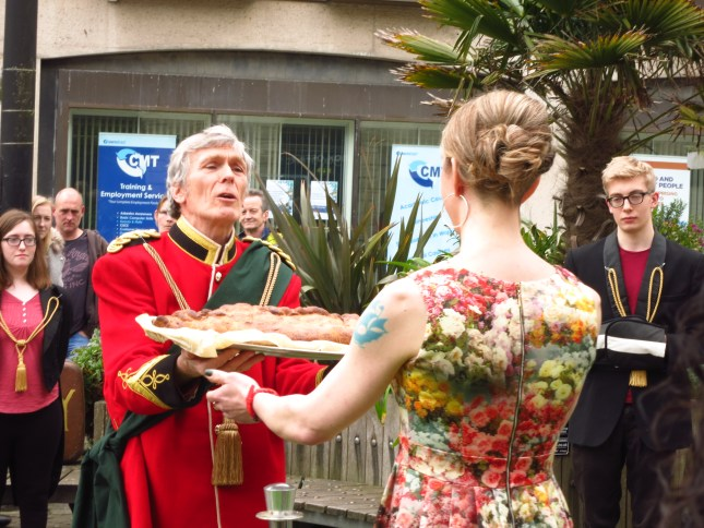 The Lord High Chancellor of the Pasty presenting the enormous pasty to Emma to be taken up to Battersea