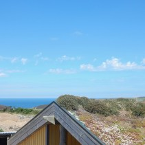 View over the green planted roof top across to Porthtowan