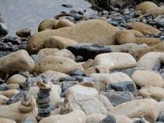 Stone sculptures on Mousehole beach