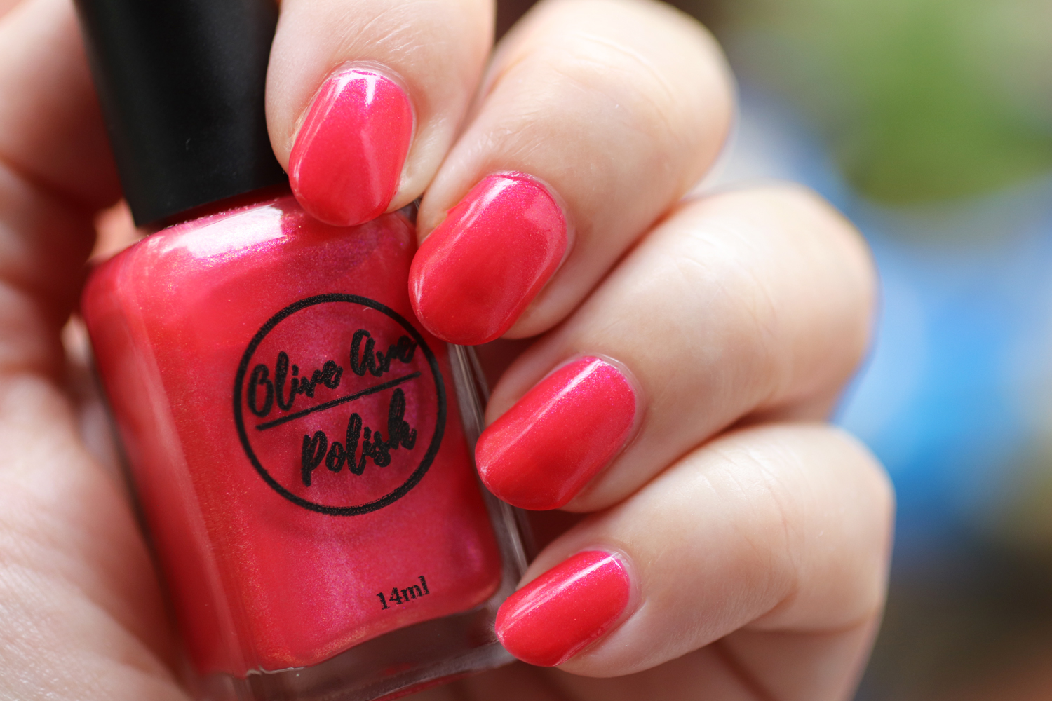 Pixy shimmery coral nail polish by Olive Ave