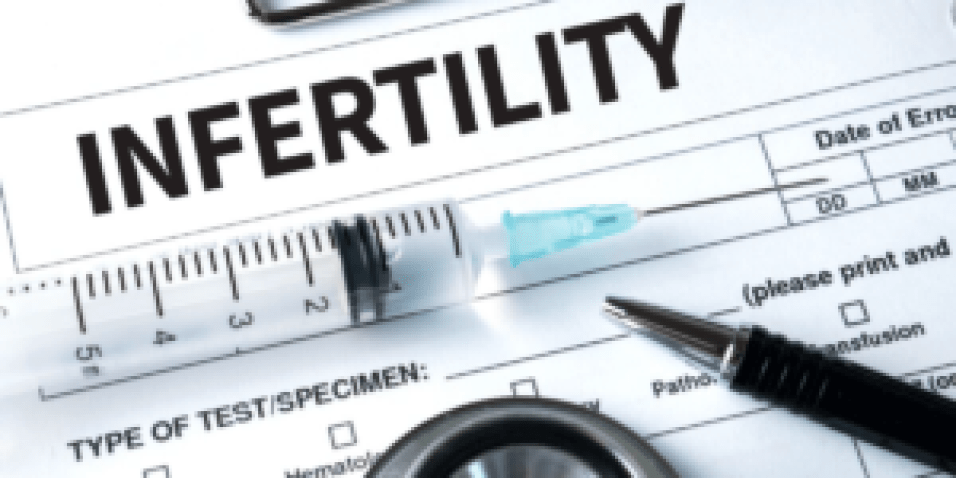 Infertility report with syringe on top of paper