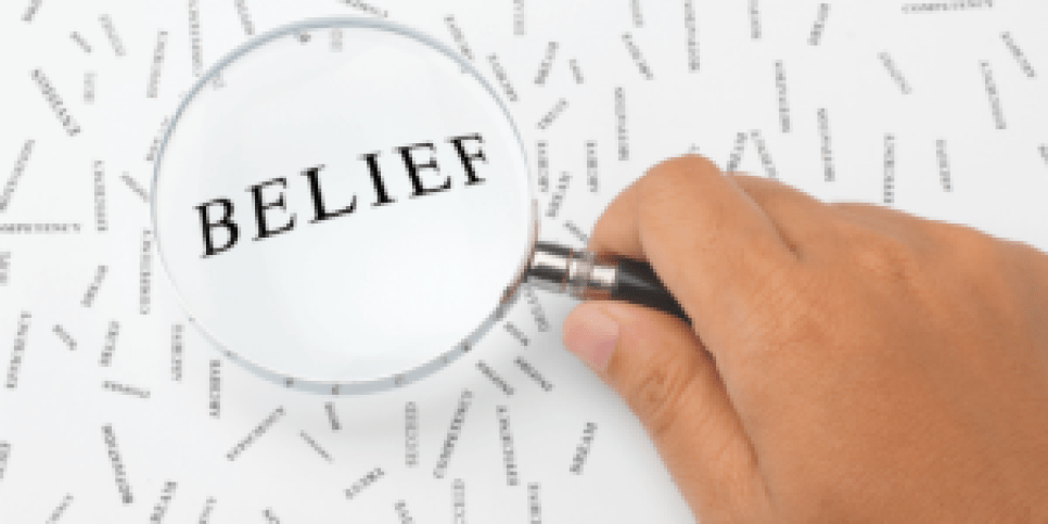 Magnifying glass over word belief