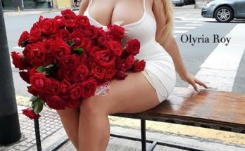 Olyria Roy with red flowers