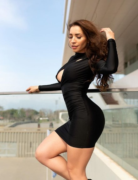 Neiva Mara in black dress