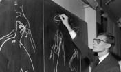 Yves Saint-Laurent Sketching On Chalkboard