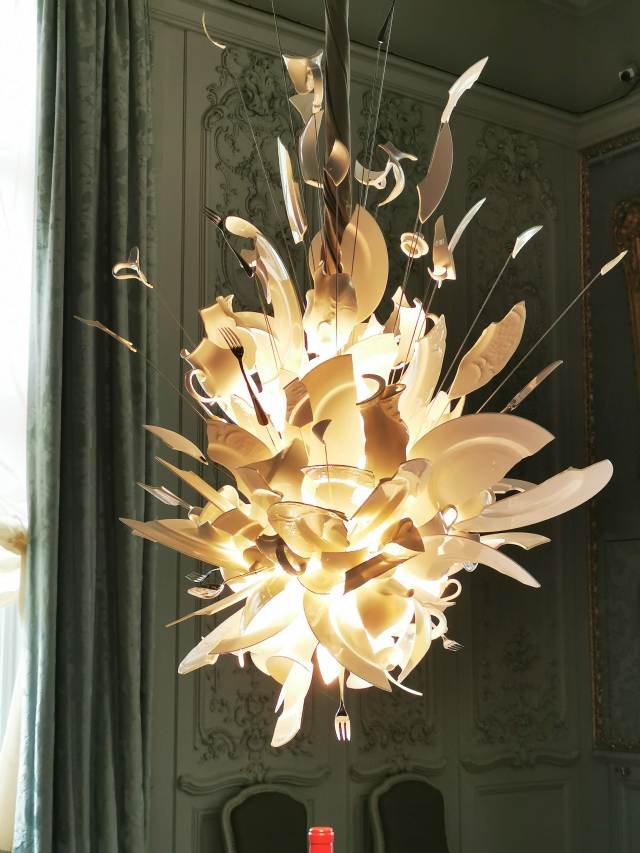 Chandelier made of broken porcelain and pieces of cutlery titled Porca Miseria