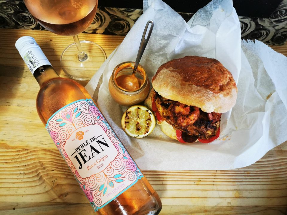 The spanish burger with a bottle of wine and grilled lemon