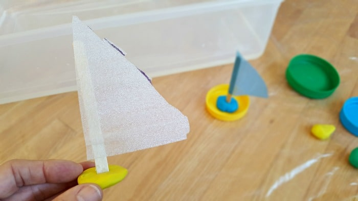 making jar lid boats for toddler water play activity