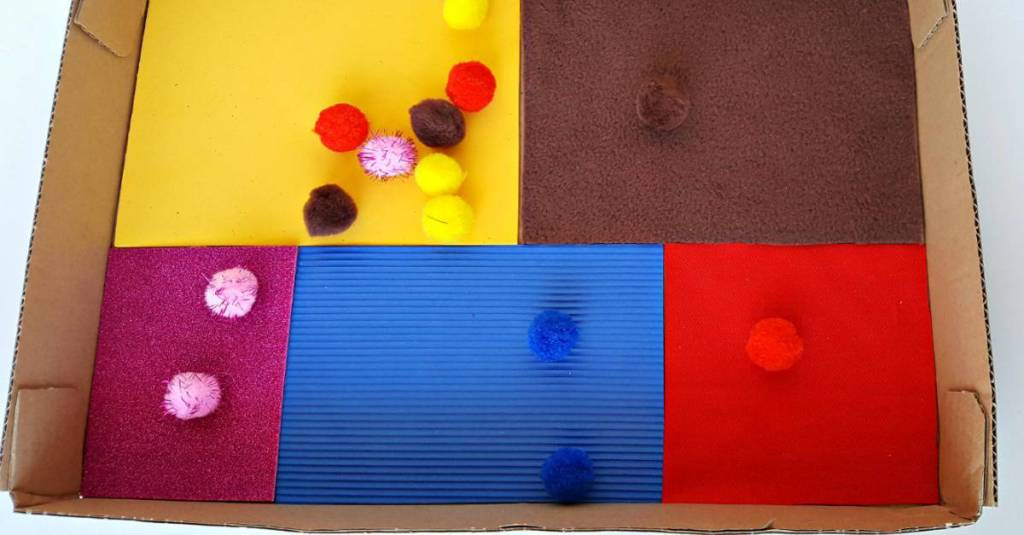 color matching toddler activity with a sensory box