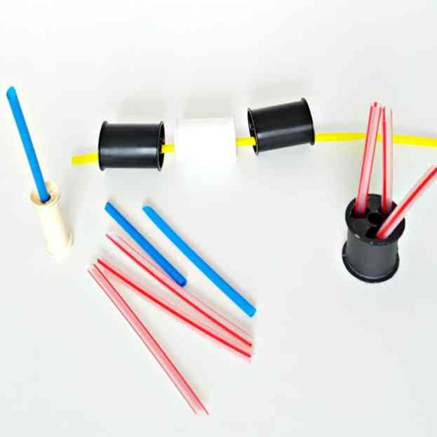 fine motor toddler play with straws and spools