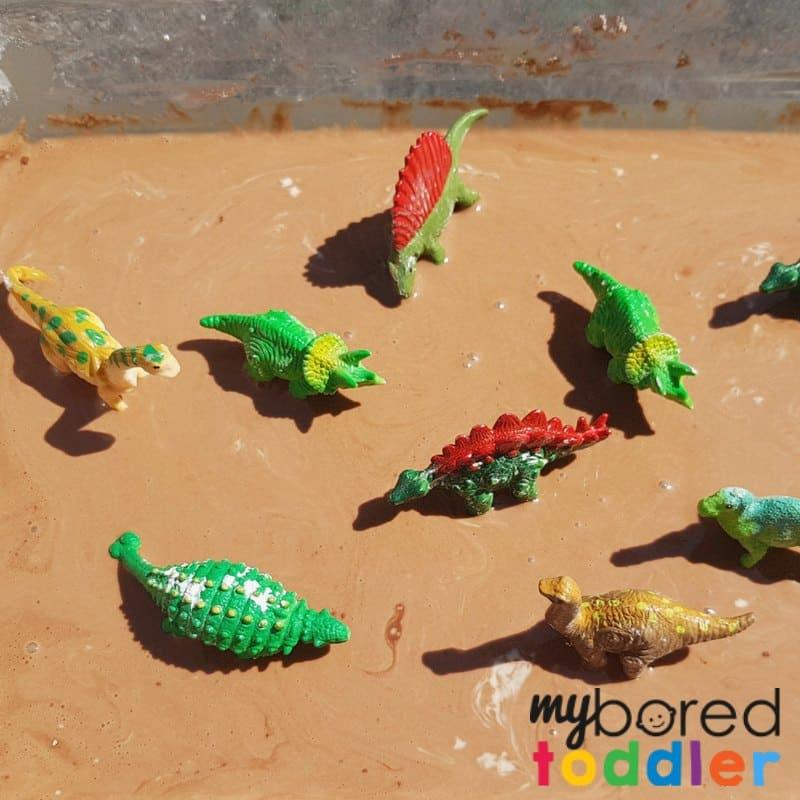 muddy dinosaur sensory bin with taste safe oobleck