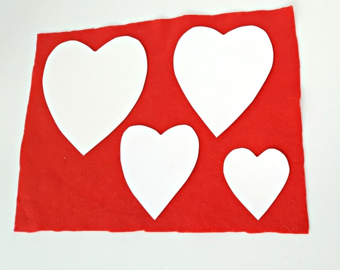 Use cardboard heart shapes as patterns to make felt cutouts