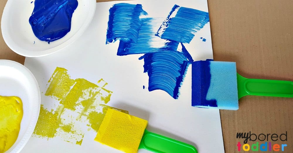 Painting with toddlers art activity using foam paint brushes