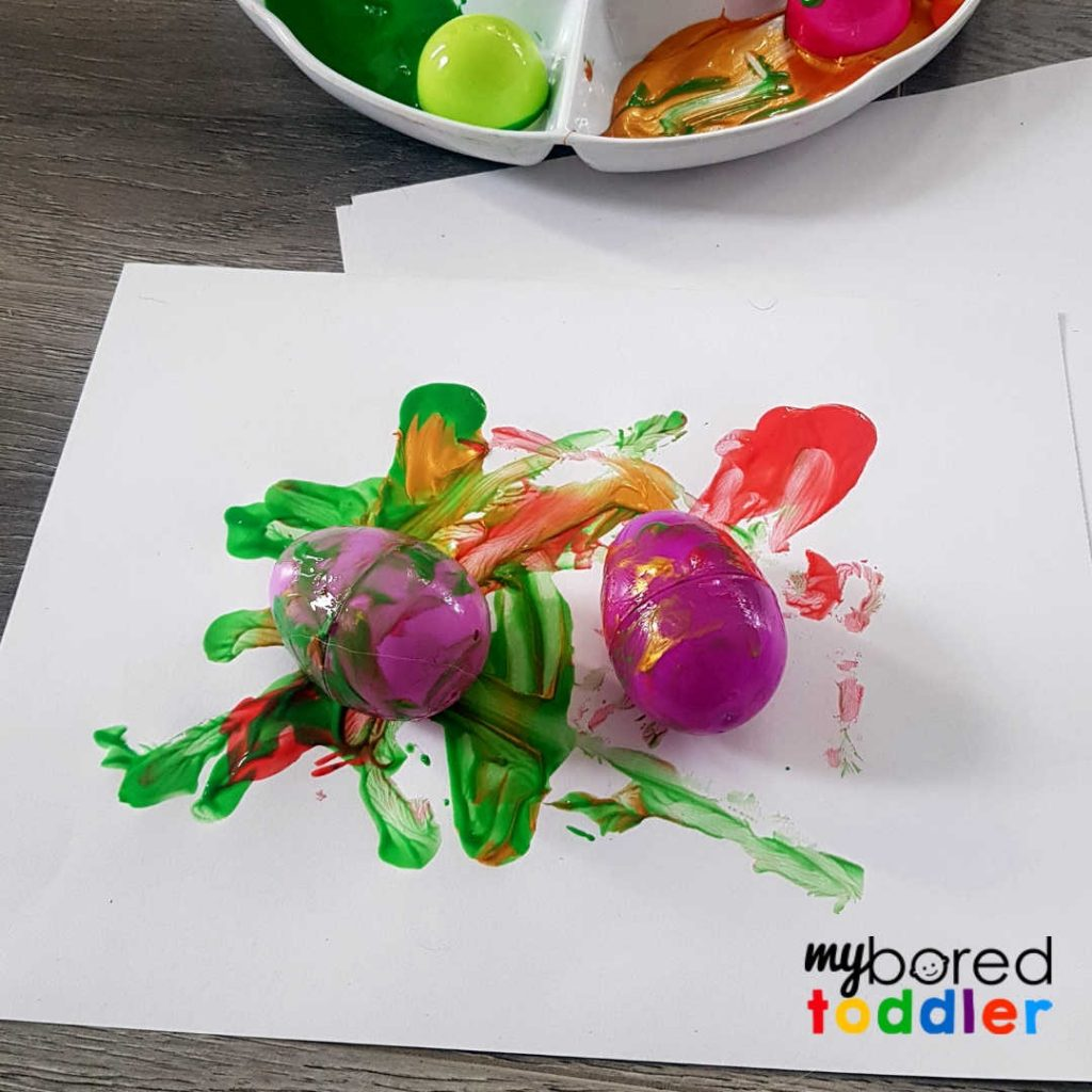 easter egg painting craft for toddlers rolling the eggs