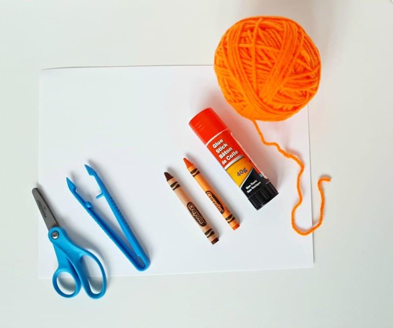 Supplies for a yarn pumpkin craft