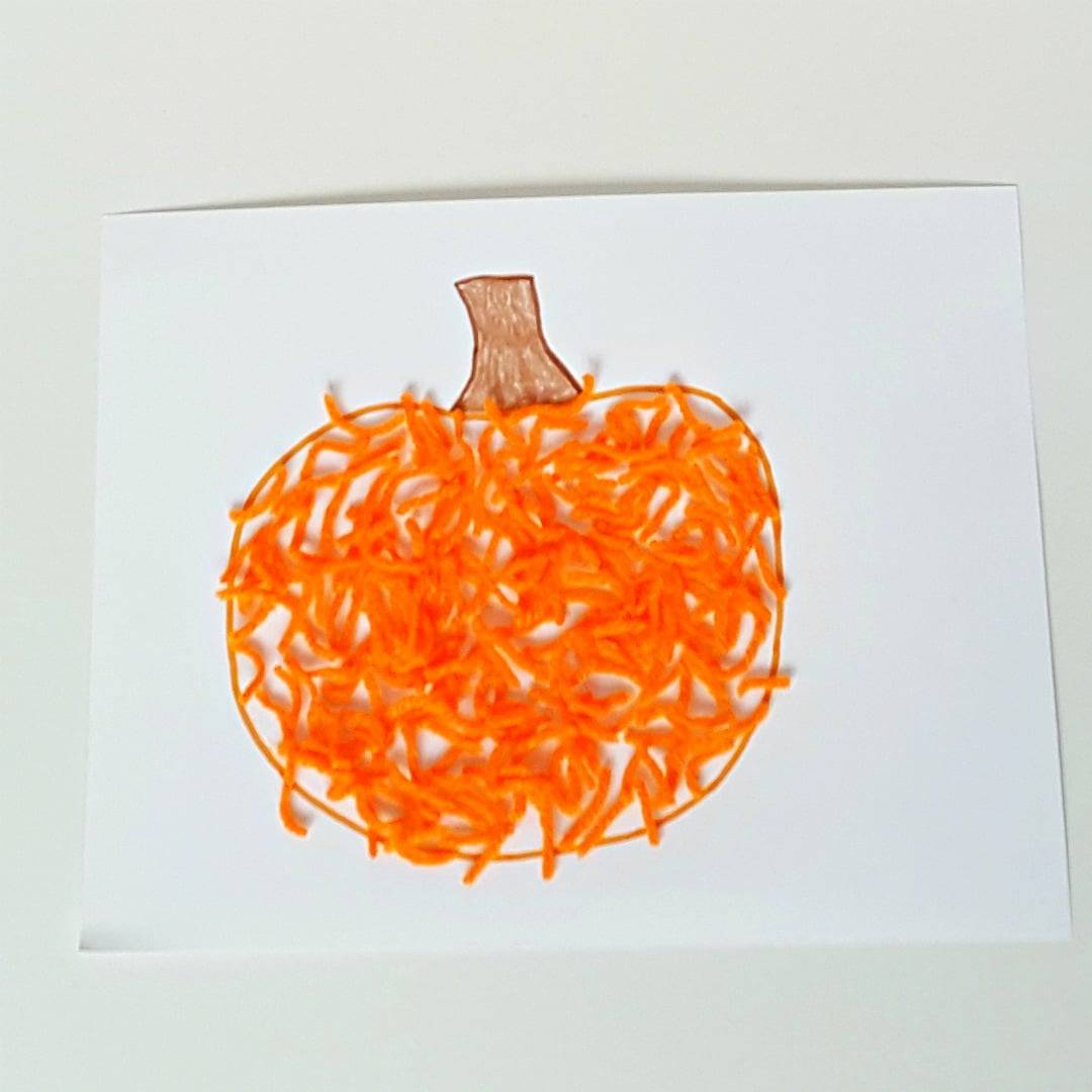 Yarn pumpkin craft for toddlers