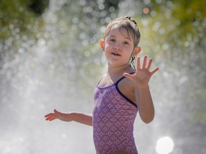 little girl in fountain
