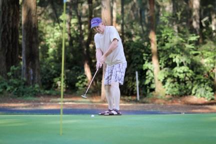 Pop-pop pretending to golf